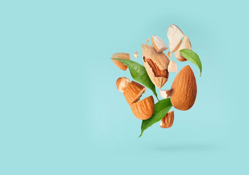 Almonds on blue background | wellness trends 2020