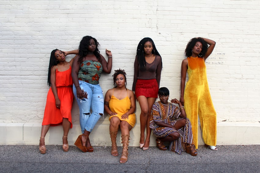 Black women against white wall | wellness trends 2020